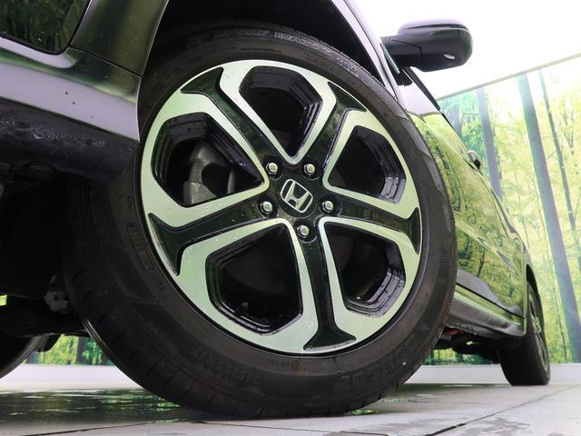ハイブリッドZ・ホンダセンシング 4WD 純正SDナビ 衝突被害軽減 レーダークルーズ LEDヘッド オートライト シートヒータ スマートキー プッシュスタート 純正17インチAW バックカメラ 電動格納ミラー ハーフレザー ETC(9枚目)