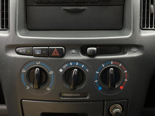 DXコンフォートパッケージ 4WD 2インチリフトアップ マキシス(新品タイヤ)ルーフラック レガリア製シートカバー 木目調ラゲージマット ハンドルカバー 純正ゴムマット ライトレベライザー キーレス 引き出しテーブル(11枚目)