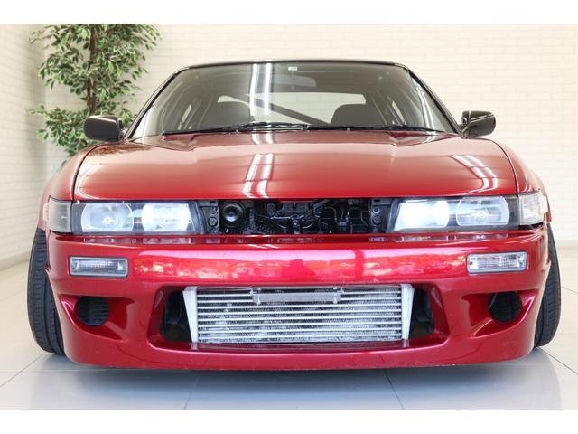 タイプX スーパーハイキャスパッケージ シルエイティ・ロケバニエアロ・ブリスターフェンダー・レイズ18インチアルミ・前置IC・車高調・7点ロールバー・3層ラジエーター・LSD・社外マフラー(34枚目)