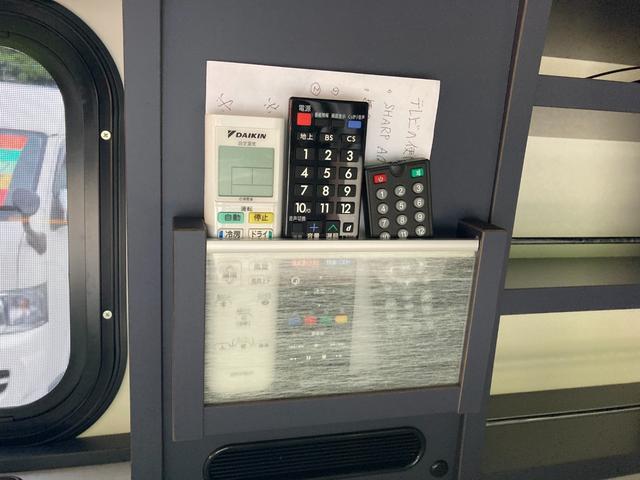 SロングDX GLパッケージ 家庭用エアコン 冷蔵庫 シンク SDナビ フルセグ バックカメラ ETC リア常設Wベッド 対座テーブルベッド エクステイションBOX キャンバー鹿児島社Rem べバストFFヒーター(27枚目)