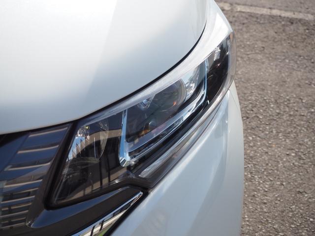 ハイブリッド・G 禁煙車 両側電動スライドドア メモリーナビTV バックモニター HIDヘッドライト スマートキー ETC バニティミラー アームレスト 乗車定員7名(4枚目)