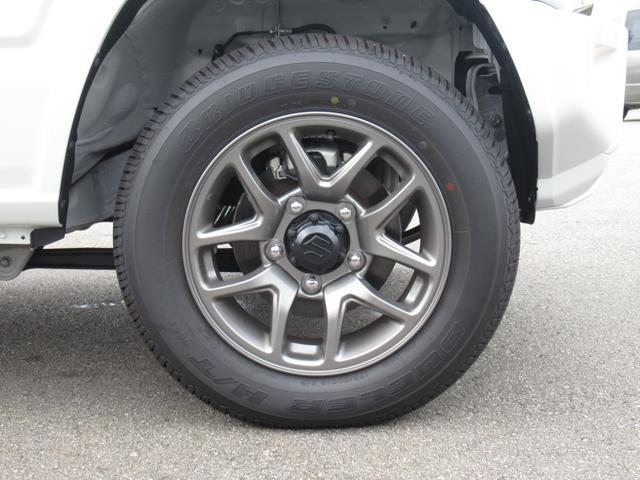 XC セーフティサポート AT車 届出済未使用車 GルックLEDデイライト付グリル 同色バンパー オーディオレス 横滑防止装置 シートヒーター クルコン スペアタイヤカバー ダウンヒルアシスト オートAC(34枚目)