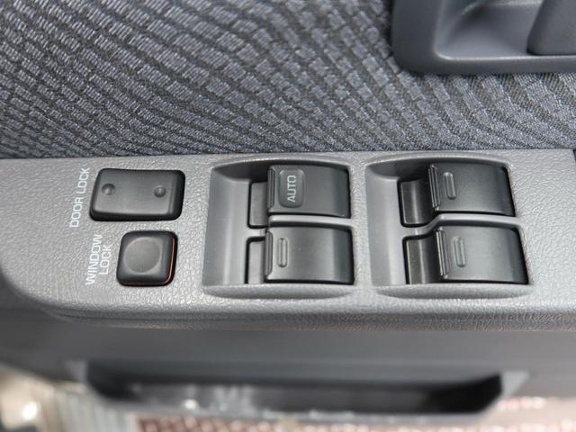 バン 5速MT 4WD ETC キーレス 背面タイヤ 純正16AW 電動デフロック パワーウィンドウ リアヒーター(22枚目)