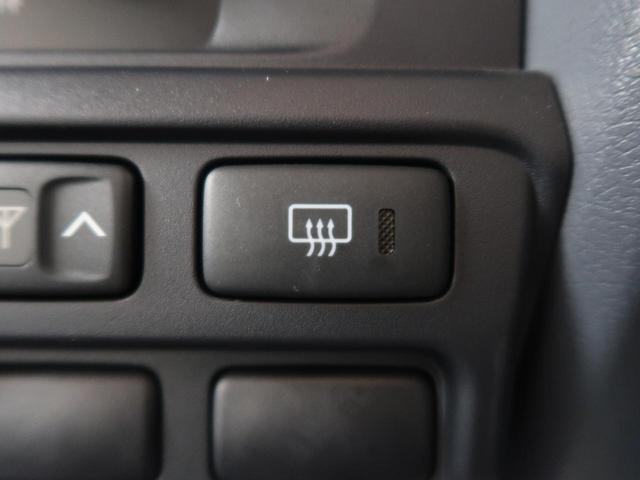 バン 5速MT 4WD ETC キーレス 背面タイヤ 純正16AW 電動デフロック パワーウィンドウ リアヒーター(27枚目)