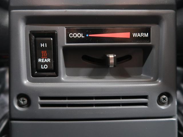 バン 5速MT 4WD ETC キーレス 背面タイヤ 純正16AW 電動デフロック パワーウィンドウ リアヒーター(34枚目)