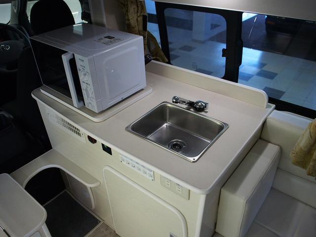 RVビッグフット W AC 4.7 社外ナビ 地デジ Bカメラ ETC ワンオーナー シンク 網戸エンゲル製DC冷蔵庫 19インチTV 4サブバッテリー インバーター FFヒーター 家庭用エアコン(7枚目)