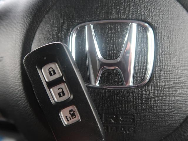 G・Lパッケージ 4WD 純正SDナビ バックモニター 電動スライドドア シートヒーター スマートキー HID ETCビルトイン 純正AW オートエアコン フォグランプ 禁煙車(8枚目)