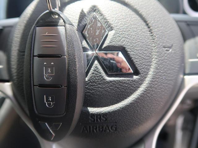 T 純正オーディオ クリアランスソナー LEDヘッド 衝突軽減装置 スマートキー 電動格納ミラー 純正15インチAW アイドリングストップ 前席シートヒーター 記録簿 禁煙車(8枚目)