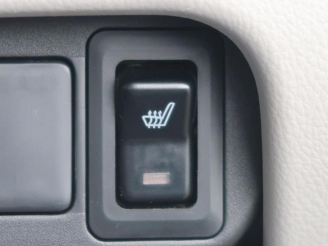 E 新品7型ナビ 地デジ 禁煙車 キーレスエントリー シートヒーター 電動格納ミラー 横滑り防止装置 プライバシーガラス ヘッドライトレベライザー(4枚目)