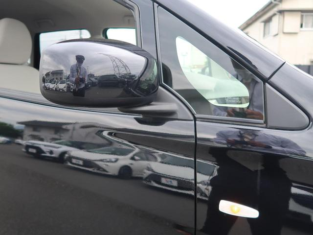 E 新品7型ナビ 地デジ 禁煙車 キーレスエントリー シートヒーター 電動格納ミラー 横滑り防止装置 プライバシーガラス ヘッドライトレベライザー(20枚目)