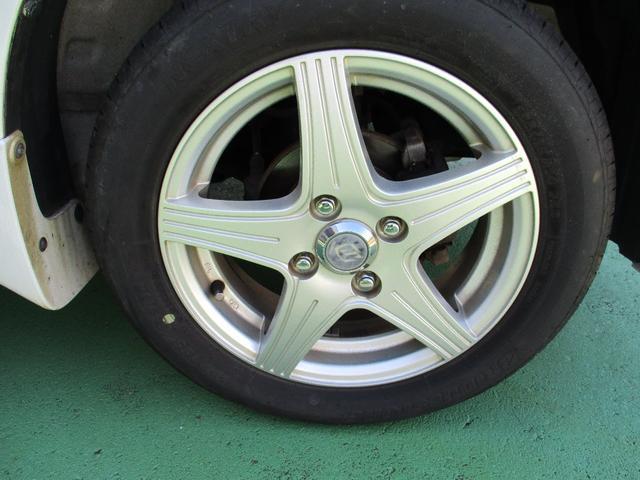 FX 4WD ワンオーナー 純正CD アイドリングストップ車 オートエアコン 運転席シートヒーター ベンチシート キーレス 社外14インチアルミホイール 電動格納ドアミラー(16枚目)