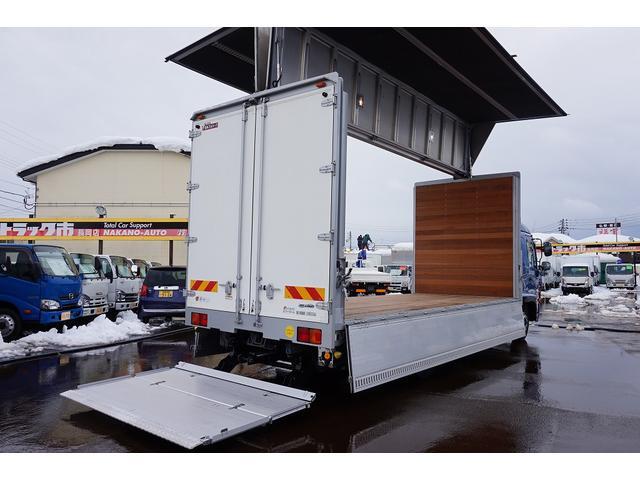 4.5t 増トン ワイドベッド付 ウイング Rエアサス R観音扉/格納ゲート1,000kg付 リモコン付 床フック6対 ラッシング2段 セイコーラック 荷室左右パネルカーペット張り 6MT(36枚目)
