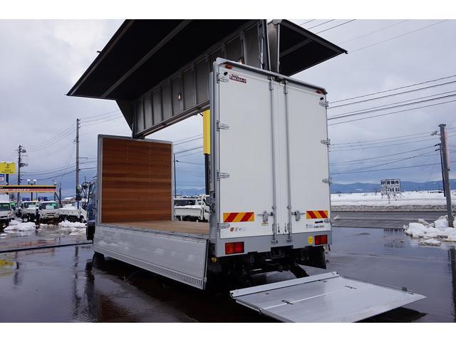 4.5t 増トン ワイドベッド付 ウイング Rエアサス R観音扉/格納ゲート1,000kg付 リモコン付 床フック6対 ラッシング2段 セイコーラック 荷室左右パネルカーペット張り 6MT(37枚目)