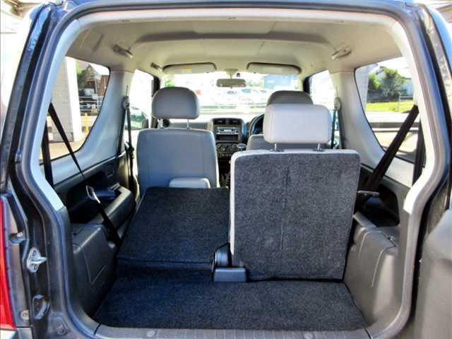 ランドベンチャー ユーザー買取車/4WD/ターボ/純正CDオーディオ/キーレスキー/ETC/純正16インチAW/運転席シートヒーター/電格ウインカーミラー/フォグランプ/ルーフレール/背面タイヤ(16枚目)