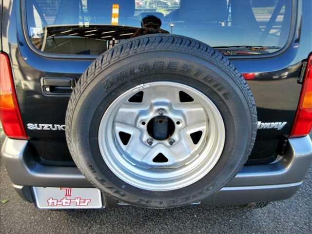 ランドベンチャー ユーザー買取車/4WD/ターボ/純正CDオーディオ/キーレスキー/ETC/純正16インチAW/運転席シートヒーター/電格ウインカーミラー/フォグランプ/ルーフレール/背面タイヤ(18枚目)