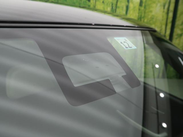 ハイブリッドMGリミテッド 2トーン 衝突軽減装置 レーダークルーズ 車線逸脱警報 前席シートヒーター パドルシフト スマートキー オートエアコン 横滑防止装置 アイドリングストップ ウィンカーミラー プライバシーガラス(3枚目)