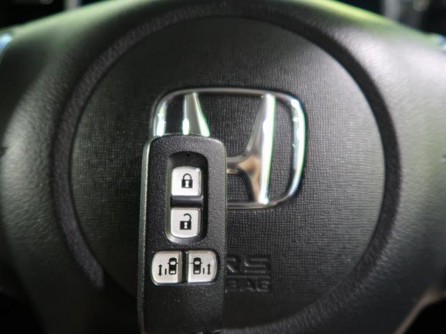 G SSブラックスタイルパッケージ 純正ナビ 衝突軽減装置 HIDヘッド 両側電動ドア シートヒーター 純正14アルミ スマートキー アイドリングストップ バックカメラ オートライト(9枚目)