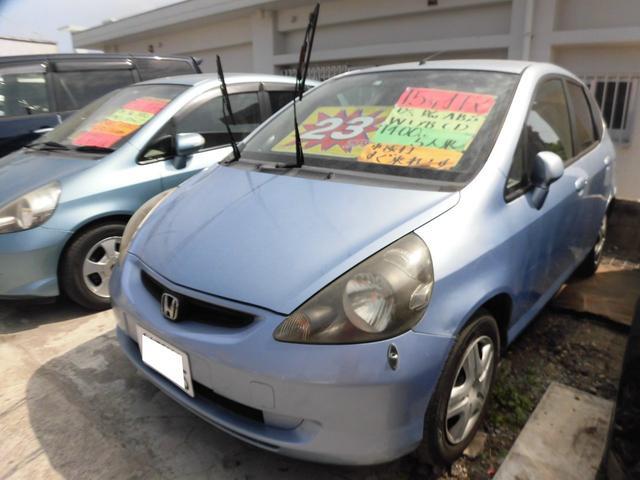 沖縄の中古車 ホンダ フィット 車両価格 9万円 リ済込 平成15年 13.4万km アイスブルーメタリック