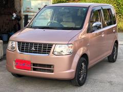 沖縄の中古車 三菱 eKワゴン 車両価格 21万円 リ済込 平成21年 10.4万K ピンク
