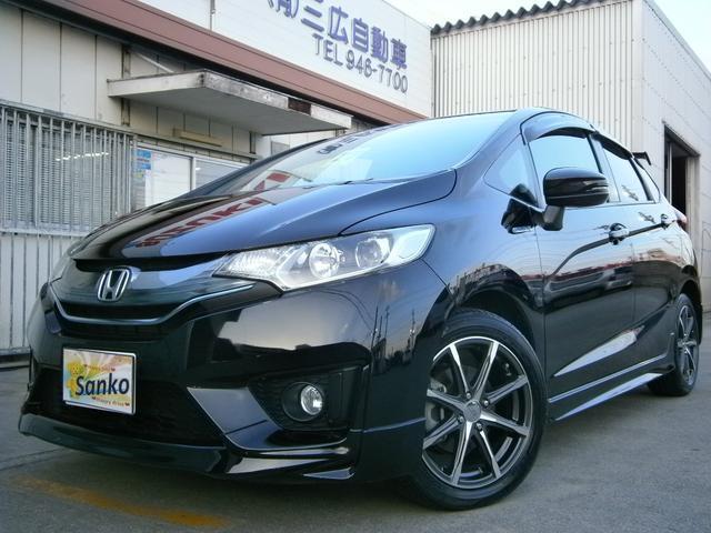 沖縄の中古車 ホンダ フィットハイブリッド 車両価格 129万円 リ済込 2015(平成27)年 5.6万km DブラックM