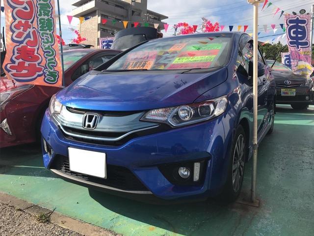 沖縄の中古車 ホンダ フィットハイブリッド 車両価格 119万円 リ済込 平成26年 6.3万km ブルーM
