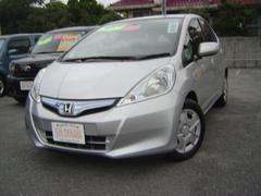 沖縄の中古車 ホンダ フィットハイブリッド 車両価格 63万円 リ済込 平成22年 8.5万K シルバーM
