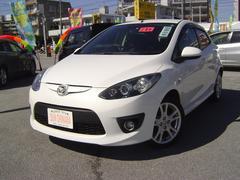 沖縄の中古車 マツダ デミオ 車両価格 58万円 リ済込 平成21年 7.7万K パールホワイト