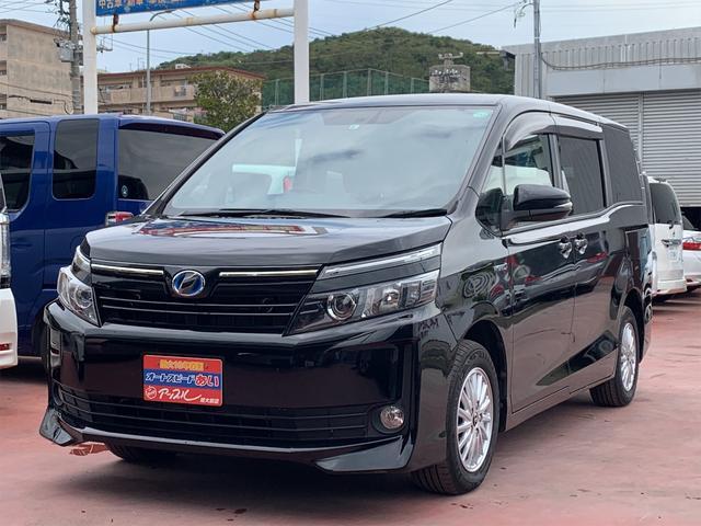 沖縄県の中古車ならヴォクシー ハイブリッドV 純正9インチナビ フルセグTV DVD再生 CDリッピング バックカメラ 両側パワースライド 置くだけ充電 エンジンプッシュスタート LEDヘッドライト フォグライト 純正15インチアルミ ETC