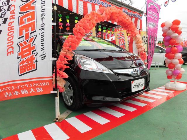 沖縄の中古車 ホンダ フィットハイブリッド 車両価格 59万円 リ済込 2013(平成25)年 6.6万km ブラック