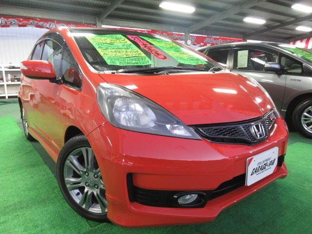 沖縄の中古車 ホンダ フィット 車両価格 39万円 リ済込 2011(平成23)年 7.2万km オレンジ