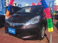 沖縄の中古車 ホンダ フィットハイブリッド 車両価格 79万円 リ済込 平成25年 6.5万K ブラウンM