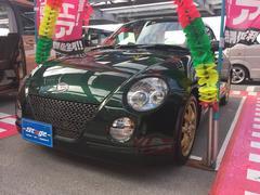 沖縄の中古車 ダイハツ コペン 車両価格 44万円 リ済込 平成15年 11.6万K グリーン