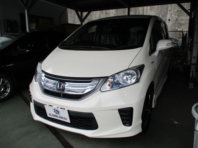 沖縄の中古車 ホンダ フリードハイブリッド 車両価格 119万円 リ済込 2012(平成24)年 7.0万km パールホワイト