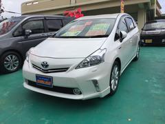 沖縄の中古車 トヨタ プリウスアルファ 車両価格 138万円 リ済込 平成25年 9.6万K パールホワイト