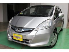 沖縄の中古車 ホンダ フィットハイブリッド 車両価格 69万円 リ済込 平成25年 7.1万K シルバーM