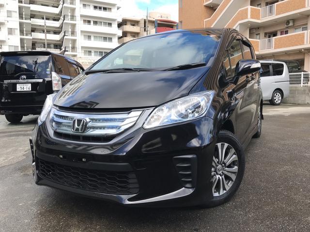 沖縄の中古車 ホンダ フリードハイブリッド 車両価格 109万円 リ済込 平成24年 8.4万km ブラック