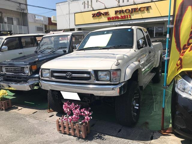 沖縄県の中古車ならハイラックススポーツピック エクストラキャブ ワイド ディーゼルターボ CD MD