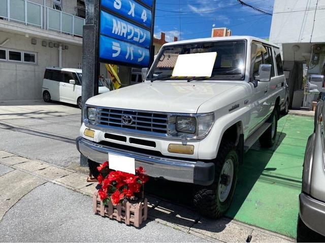 沖縄県宜野湾市の中古車ならランドクルーザープラド SX5 4WD ディーゼルターボ リフトアップ ナローボディ 社外ウッドハンドル