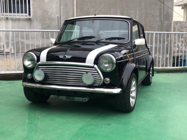 沖縄の中古車 ローバー MINI 車両価格 115万円 リ済別 1999(平成11)年 7.3万km ブラック