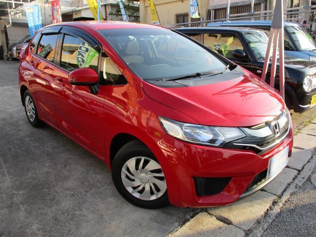 沖縄の中古車 ホンダ フィット 車両価格 65万円 リ済込 2013(平成25)年 8.2万km ミラノレッド