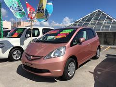 沖縄の中古車 ホンダ フィット 車両価格 69万円 リ済込 平成22年 5.7万K ピンク