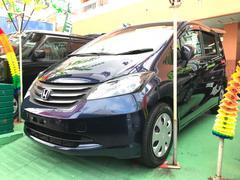 沖縄の中古車 ホンダ フリード 車両価格 99万円 リ済込 平成23年 7.3万K ダークブルー