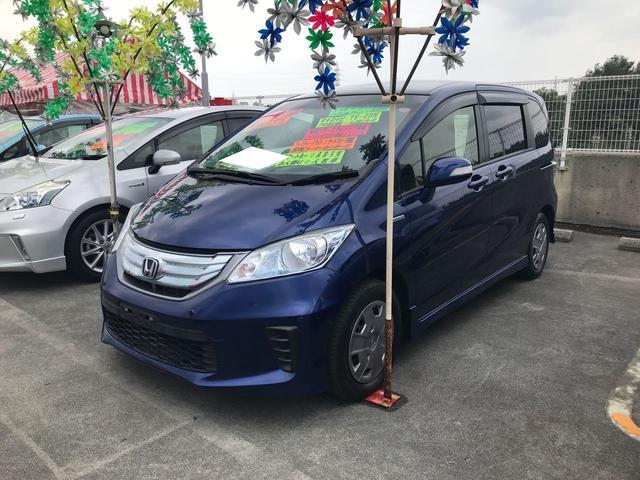 沖縄の中古車 ホンダ フリードハイブリッド 車両価格 119万円 リ済込 平成24年 7.4万km ブルー