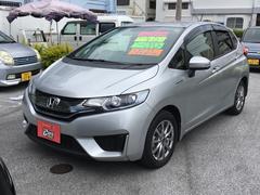 沖縄の中古車 ホンダ フィットハイブリッド 車両価格 118万円 リ済別 平成25年 4.3万K シルバー