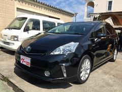 沖縄の中古車 トヨタ プリウスアルファ 車両価格 129万円 リ済込 平成24年 6.9万K ブラック