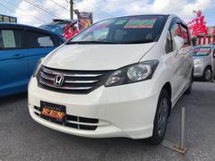 沖縄の中古車 ホンダ フリード 車両価格 49万円 リ済込 平成22年 9.5万K パールホワイト