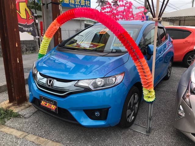 沖縄の中古車 ホンダ フィットハイブリッド 車両価格 68万円 リ済込 2016(平成28)年 9.0万km ブルー