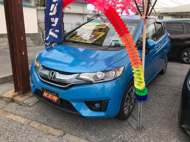 沖縄の中古車 ホンダ フィットハイブリッド 車両価格 69万円 リ済込 2014(平成26)年 9.0万km ブルー