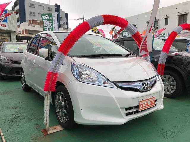 沖縄の中古車 ホンダ フィットハイブリッド 車両価格 86万円 リ済込 平成25年 6.7万km タフタホワイト