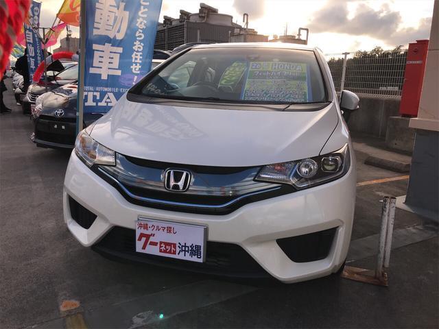 沖縄県の中古車ならフィットハイブリッド Lパッケージ ナビ・TV・バックカメラ 2年保証